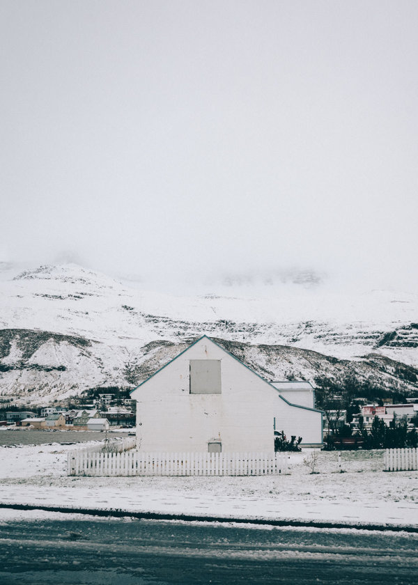 House by the road in the winter in Seyðisfjörður