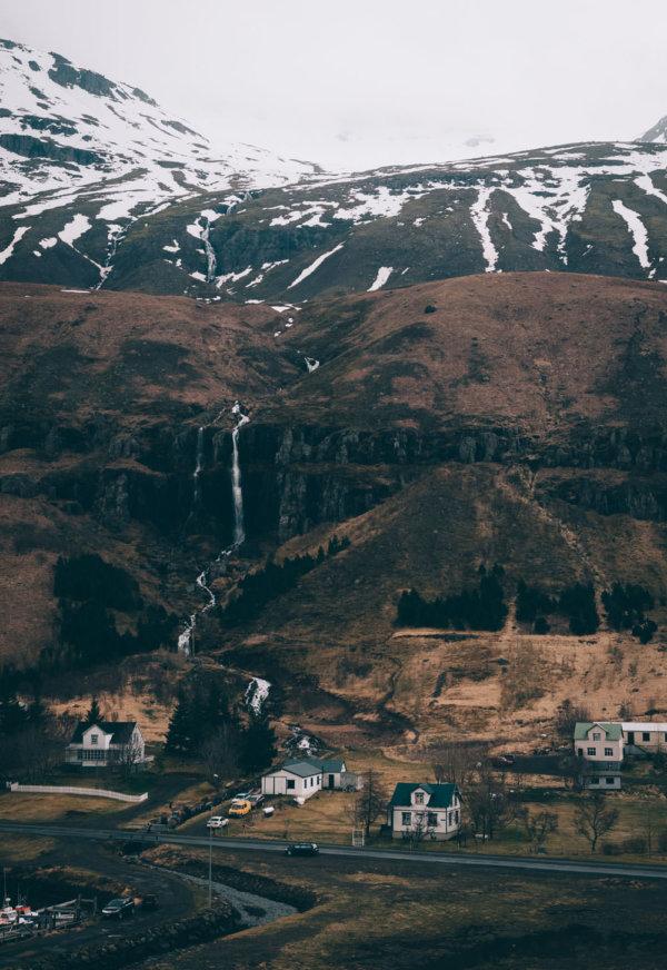 Houses by a waterfall in Seyðisfjörður, Iceland