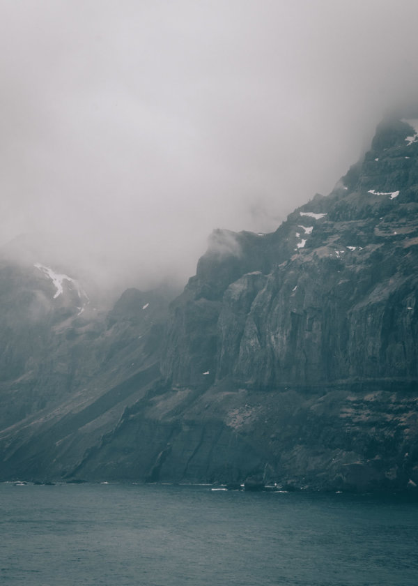 Mountains in the fog in Seydisfjordur Iceland