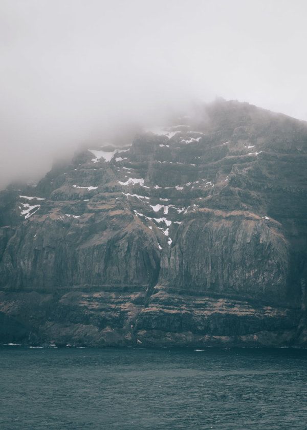 Fjord of Seydisfjordur in the fog, Iceland