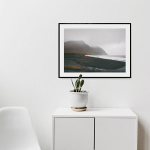 Scandinavian wall art - small red cabin on Icelandic black sand beach in the Westfjords. Check out original Scandinavian art prints by Adam Biernat at Bite of Iceland.